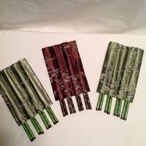 chop sticks , three sets of 8 , 2 green 1 brown